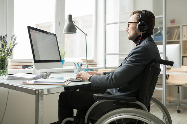 SaaS contract template: man in a wheelchair working